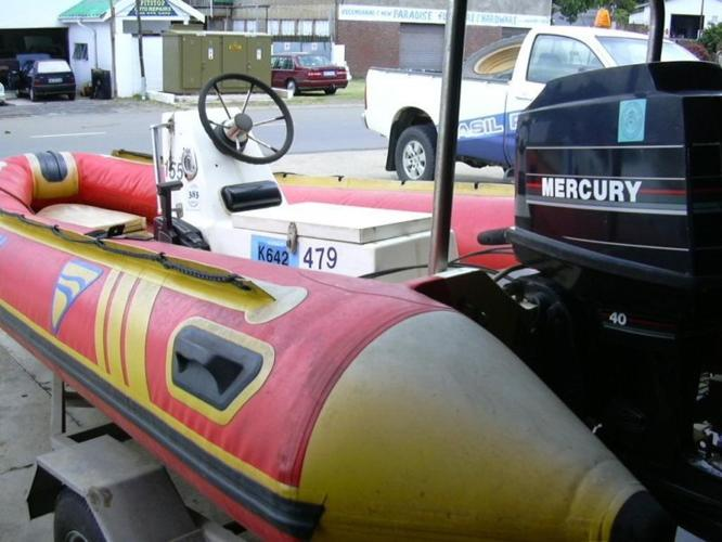 4m Inflatable boat with a 40hp motor on trailer.