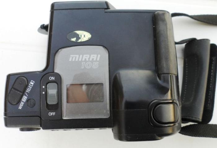 Camera. Ricoh Mirai 105. 35mm film. Advanced autofocus,
