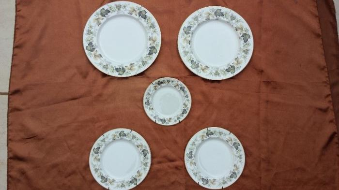 Collection of 5 Royal Doulton wall plates.