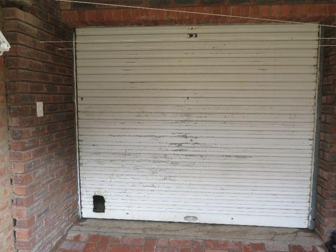 Galvanised roll up single garage door