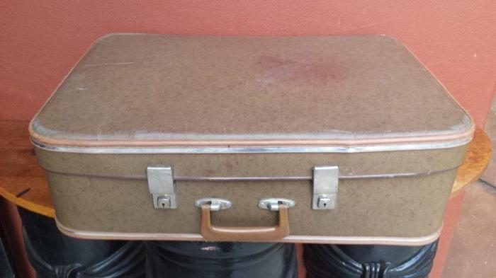 Large old brown suitcase.
