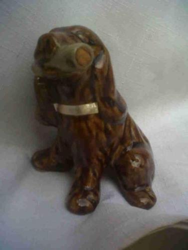 Old ceramic Cazanova dog decanter.