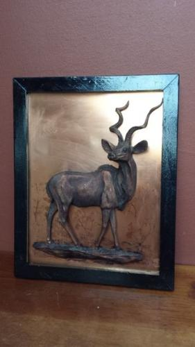 Old copper buck wall hanging.