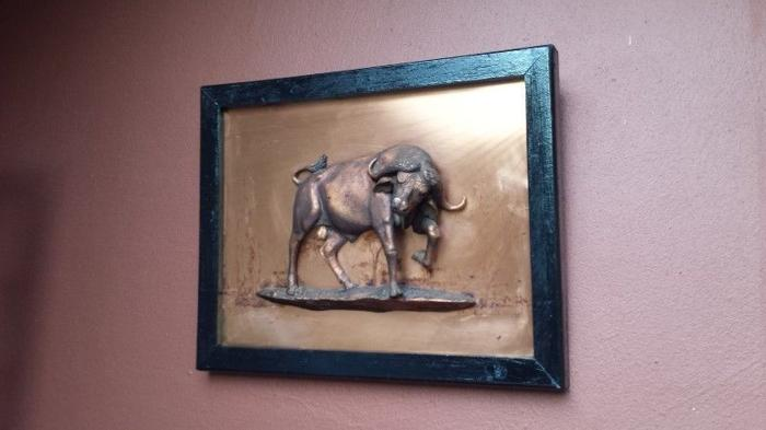 Old copper wildebeest wall hanging.