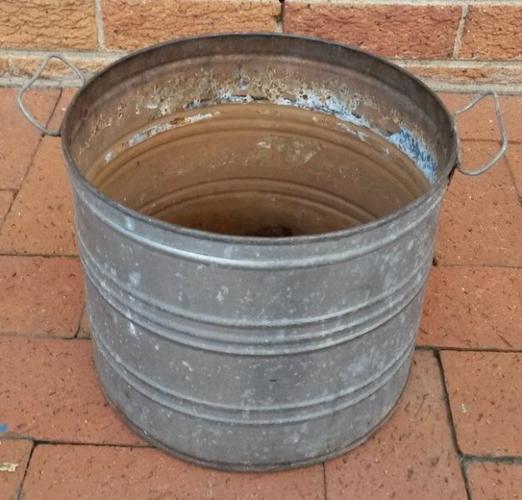 Old galvanized iron planter