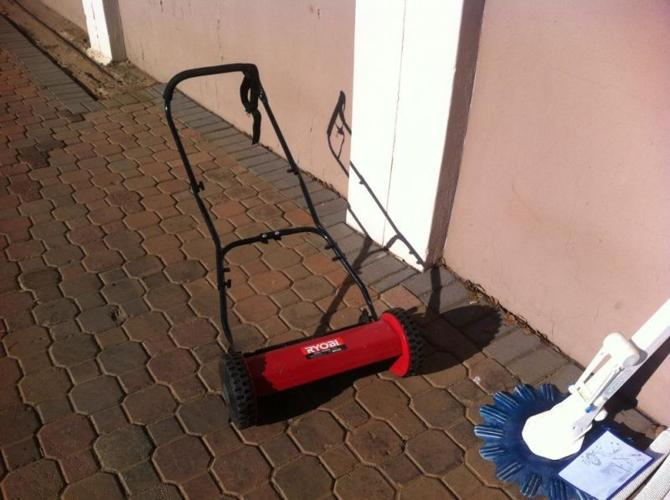 Ryobi lawn mower moving to flat must sell