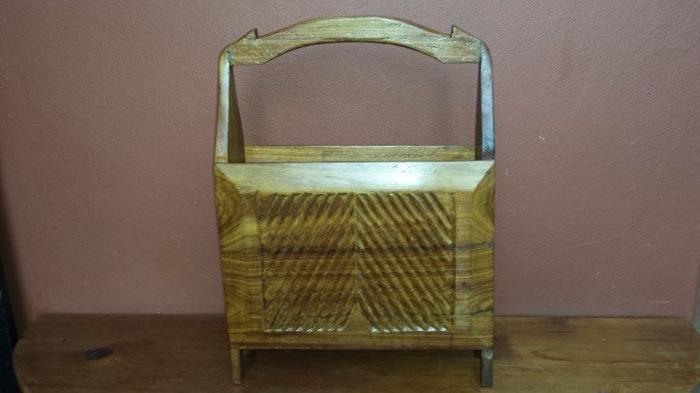 Solid wood magazine rack.