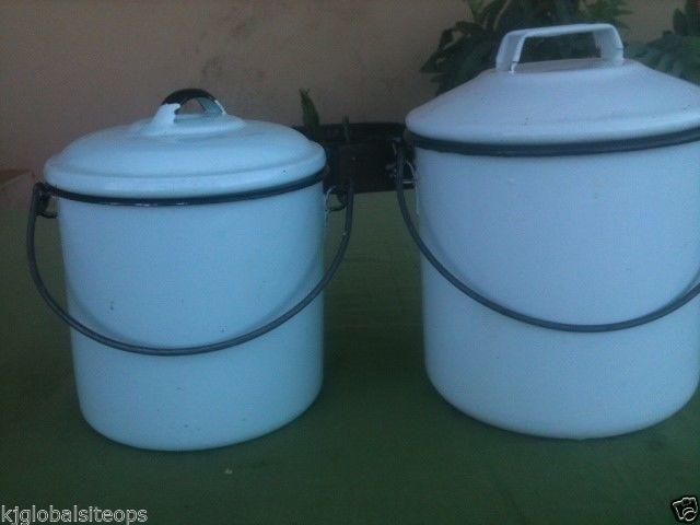 Two spotless enamel buckets