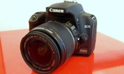 Selling my Canon 1000d. Comes with: 18-55mm kit lens,