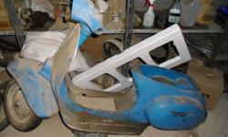 Vespa stripped down for respray...lost interest...in