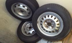 "Three 13"" rims with used tires, from Opel corsa,"