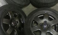 14 Inch gunmetal citi rims and continental tyres for