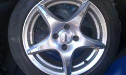 "15"" mag tsw mag rims,has scratches,tyres need replacing"