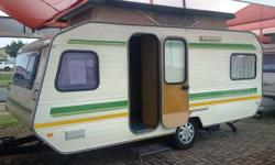 1983 Caravette 6L in good condition with a full tent