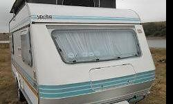 Year Model : 1990 Make : Sprite Sport The Caravan is in