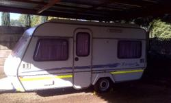 SPRITE C.I. ESCAPE CARAVAN FOR SALE, HAS ITS AWNING AND
