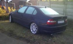 Good Condition BMW 320i Auto Individual. Dark Blue