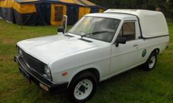 Nissan 1400 goes for R44999 Neg. including canopy. AC,