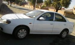 Im selling my Nissan Almera 1.6,Radio,A/C, Power