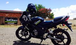 CBR 125R excellent condition. Custom pearl black paint