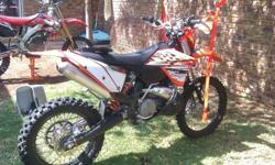 KTM 250 2stroke with enduro guards. With spare filter