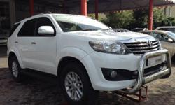 New shape Fortuner with,  Leather seats,  Auto head