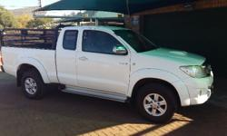 White Toyota Hilux Cattle Rails included.