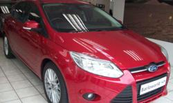 Available in candy red with only 64 000 kms.  Sold with