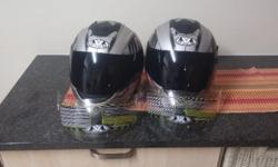2 Silver Vega helmets with dark and clear vizors for