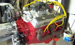 350 CHEVY ENGINE. COMPLETELY OVERHAULED. REBORED WITH