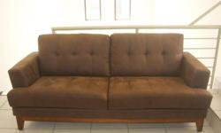 Comfortable 3 seater couch in upholstered in brown