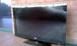 "Hi! I'm selling this 42"" LCD LG with a stand in very"