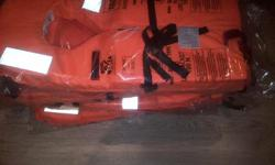 4 brand new original 100N life jackets in sealed