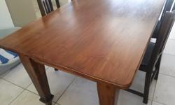8 seater dining table, solid Oregon top and legs.