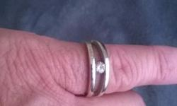 9 Ct white gold millenium ring with 20 point diamond