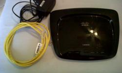 Beskrywing Linksys by Cisco ADSL modem router Wireless