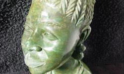 i am selling 12 x african verdite carved stone heads.