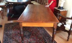 Yellow wood and stink wood dining room table.