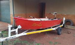 Aluminum boat on trailer with two paddles, 44 electric