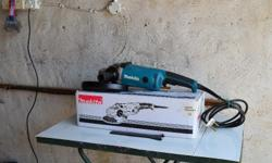 Makita angle grinder Brand New , used once to test.