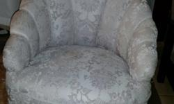 Antique reupholstered boudoir chair.