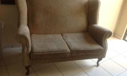 Queen Anne wingback sofa. Excellent condition.