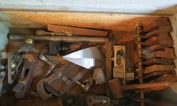A collection of antique planes, saws, braces etc in 2
