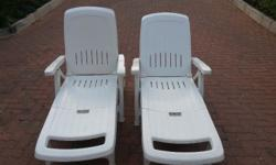 2 x one year old white plastic foldaway Sun Loungers