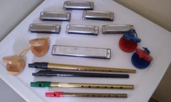 7 harmonicas various keys,4 whistles,2 sets hand caster