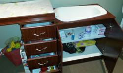 In good condition with original babybath and changing
