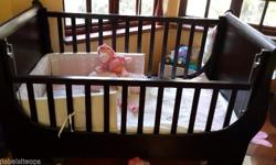 Baby cot dark brown. The cot has hardly been used it