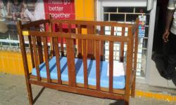 Wooden baby cot. With mattress. Still in good