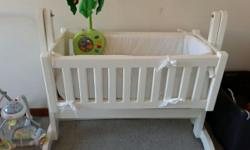 Swaying baby cot, mattress, cot bumpers and mobile