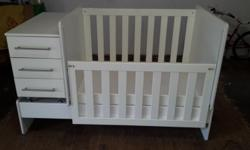 White wooden baby cot & bed with separate drawers.